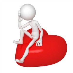 Lonely lover sitting on red heart